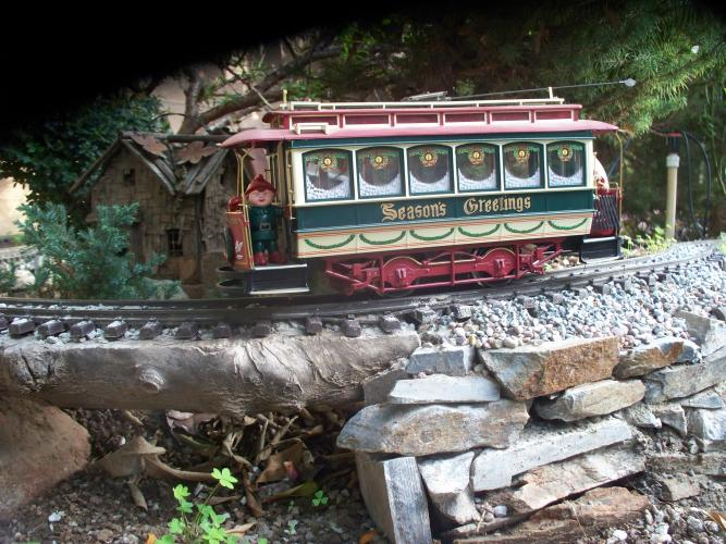 Christmas trolley on rebuilt Red Mountain retaining wall.